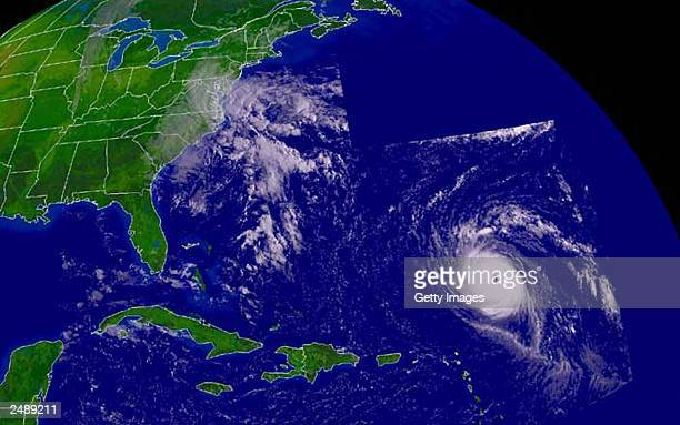 This is an handout satellite image from NOAA of Hurricane Isabel and its proximity to the US eastern coastline along with the remnants of what as...
