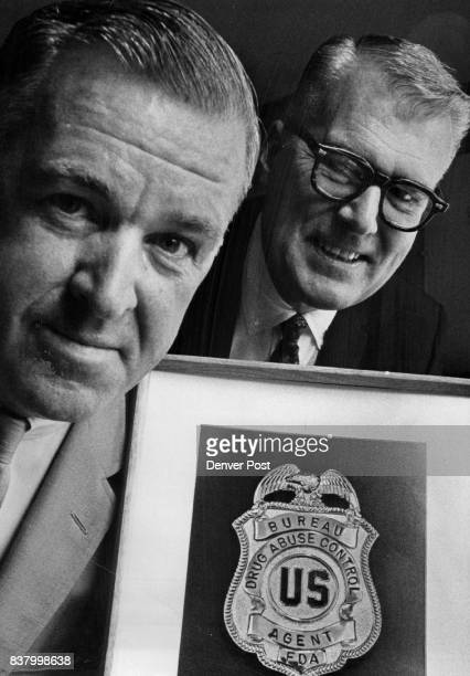 This is Badge for Bureau of Drug use Control John S Healey left Denver field director and John H Finlator federal director discuss education and...