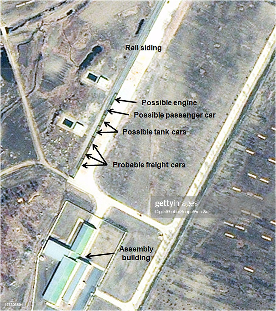 This is Figure 6. Railcars parked at the train siding at Sohae. Satellite imagery taken March 29, 2013.