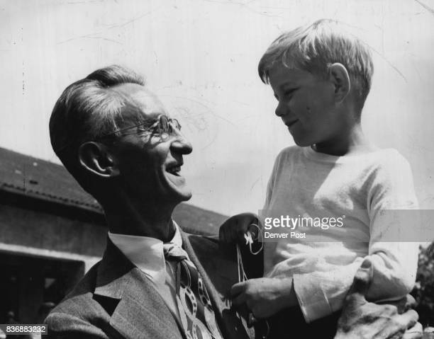 This is Gunnar 5 1/2 year old with Lawrence Martin associate editor of the Denver post in the children's international village at Bad Aibling Germany...