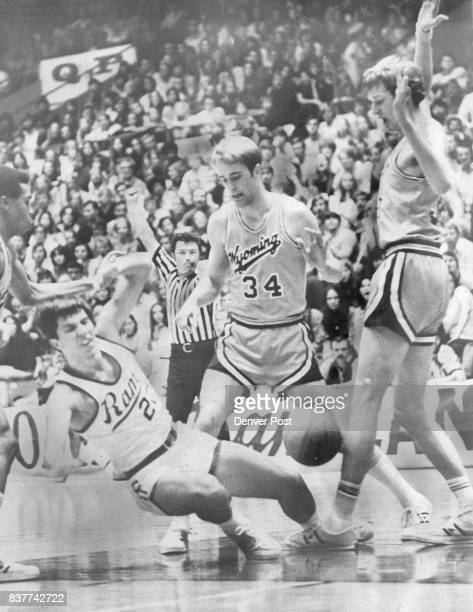 This Is No Time To Be Sitting Down On The Job Gary CSU's Gary Rhoades is about to have a seat on the floor after crashing into Wyoming's Ted Roney...