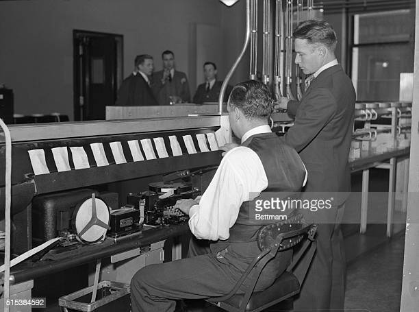 This is one of a series of photographs which illustrate the complicated machinery of the New York Stock Exchange and how it is set in motion by even...