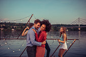 Cropped shot of a young couple dancing on a boat