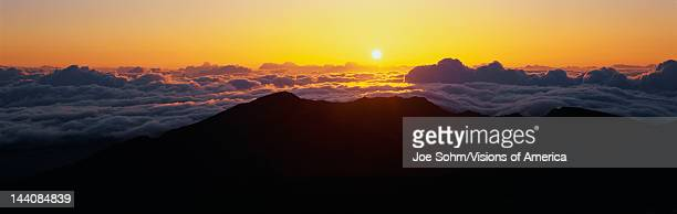 This is sunrise from Haleakala Volcano Summit located at Haleakala National Park These are the cloud formations over the top of the volcano