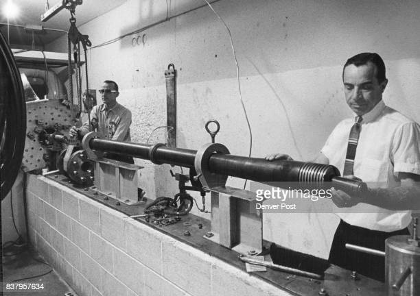 This Is The 37MM Light Gas Gun 120 Feet Long Which Fires Particles To Test Materials Bill Burkitt left of the Martin Co and William G Howell of...