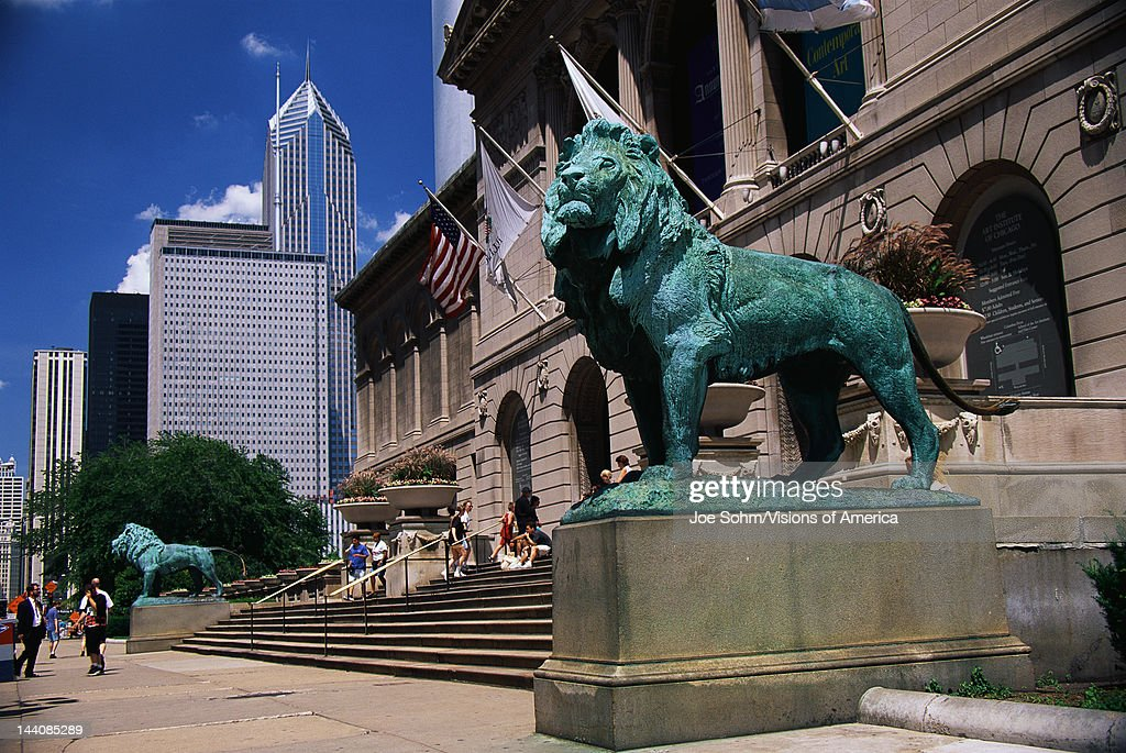 This is the exterior of the Art Institute of Chicago The famous lion statues are guarding its entrance