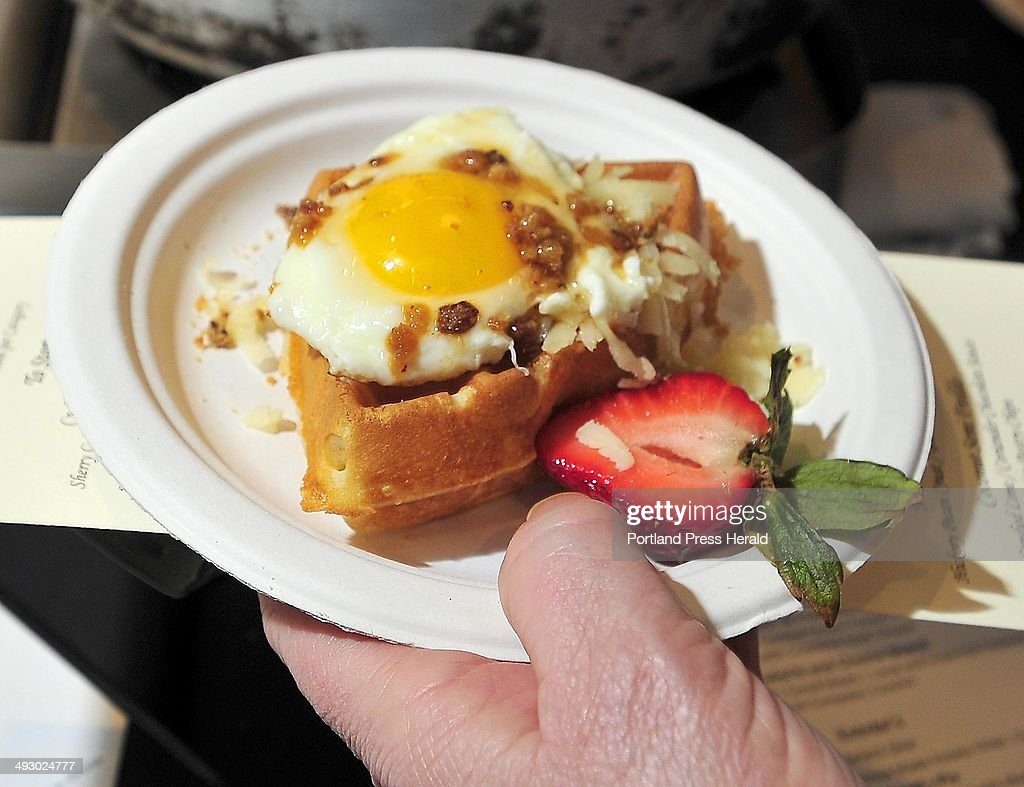 This is the first place winning breakfast creation by Chef Tim Labonte from Eve's, Portland Harbor Hotel, Bacon, Egg & Cheese Waffle, (pork belly waffle topped with Maine cheddar, maple bacon crunch & sunny side of egg.) People enjoyed great breakfast food created by area restaurant chefs at the Incredible Breakfast Cook-Off at Sea Dog Brewing in South Portland Friday, February 28, 2014.