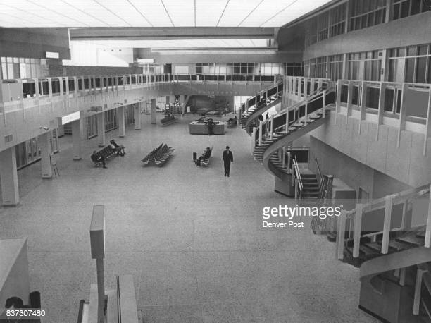 This is the 'grand gallery' in the Stapleton terminal Off to the left are the airline ticket counters and the auto ramp for outgoing passengers...