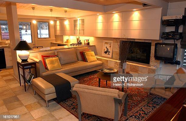 This is the living room and the kitchen of the home of Frank and Dawn Nowak's 855 sq ft midcentury modern home at 1441 E Dartmouth