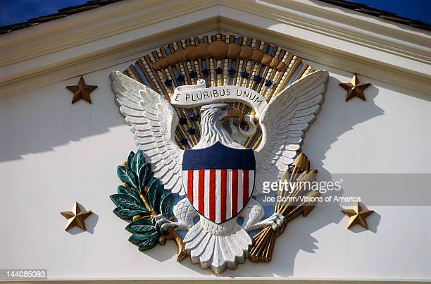 This is the National Emblem situated on the building of the Herbert Hoover National Historic Library It shows the American eagle holding in its claws...