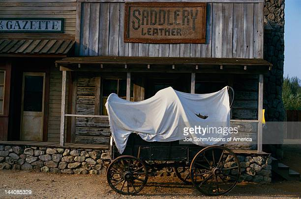 This is the Paramount Ranch showing what the old west looked like There is a covered wagon in front of an old newspaper office