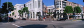 This is the shopping district on Rodeo Drive and Via Rodeo Drive in Beverly Hills There is a Rolls Royce parked on the corner showing the wealthy...