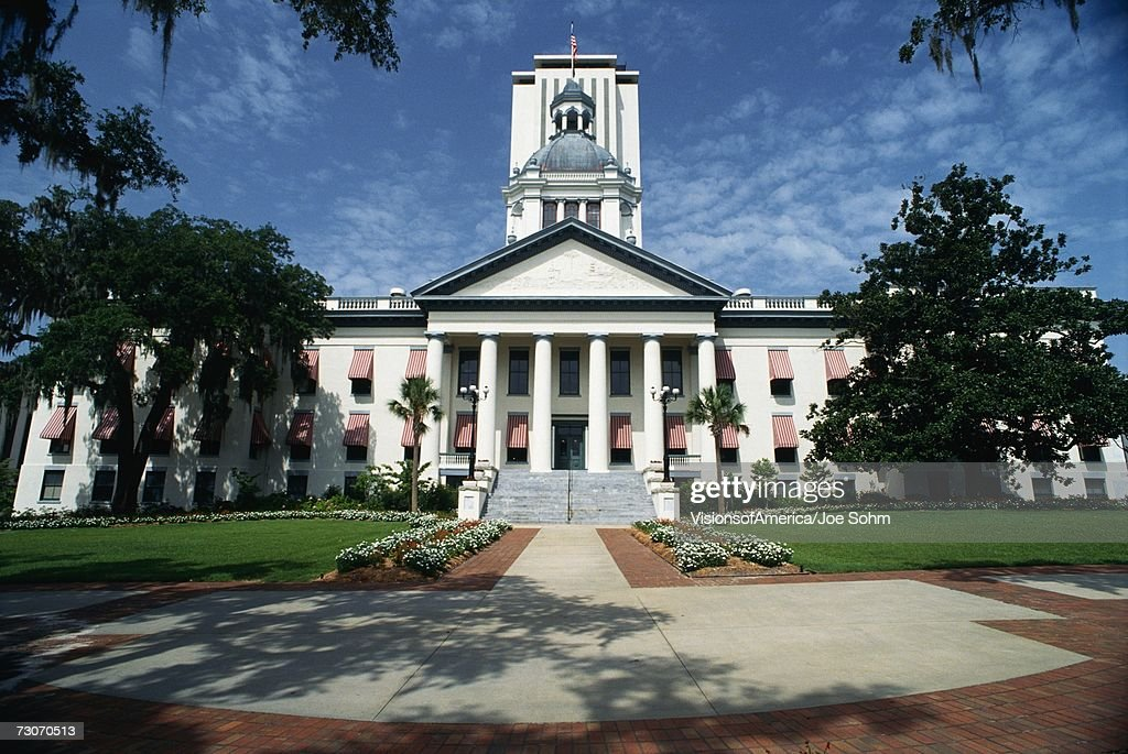 This is the State Capitol building. It has a large concrete stairway leading up to it with large columns holding up the facade.