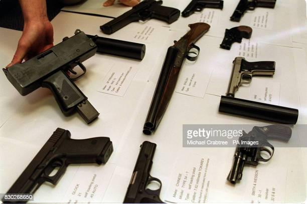This is the terrifying haul of guns used by gangsters in some of the 21 Yardiestyle murders on display at New Scotland Yard The cache includes a...