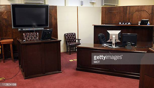 This is the view of the witness stand below the flatscreen monitor and at right Judge Patrick Parrish's bench above the court reporter spot that will...