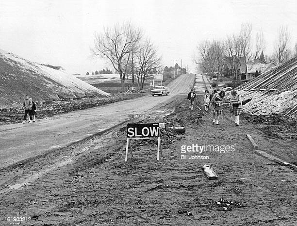 MAR 29 1965 MAR 30 1965 This Is Way We Go to School Muddy This muddy crossing at W 48th Ave and Tennyson St on the construction site of Interstate 70...