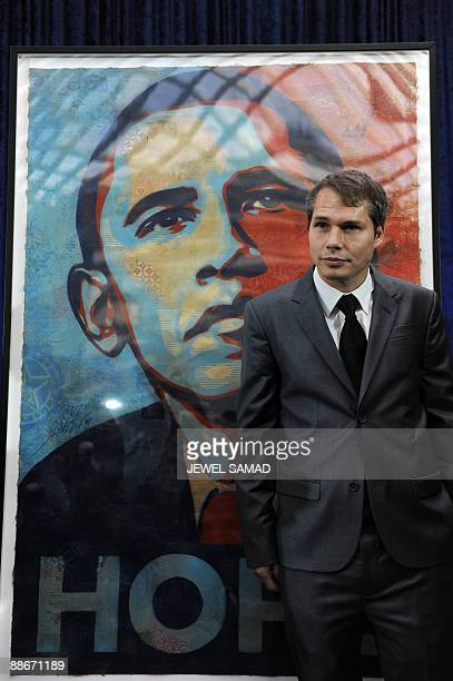 This January 17 2009 file photo shows artist Shepard Fairey unveiling his portrait of then US presidentelect Barack Obama before it was installed at...