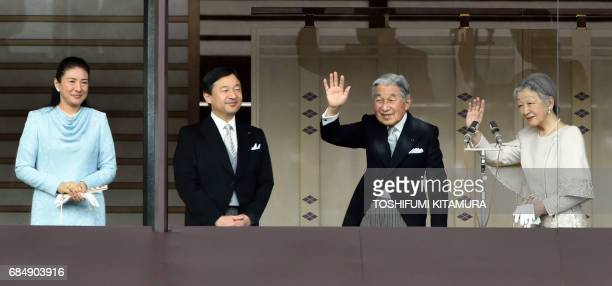 This January 2 2015 file picture shows Japan's Emperor Akihito and Empress Michiko waving to wellwishers while Crown Prince Naruhito and his wife...