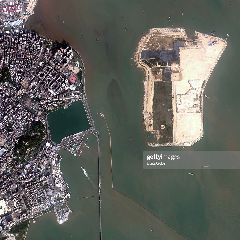 This January 9, 2013, image provides an overview of the reclaimed land project adjacent to the Macau Peninsula. Several ships are seen unloading fill material, and earth-moving vehicles are supporting construction work on the artificial island. The project is led by the China Road and Bridge Corporation (CRBC) at an estimated total cost of USD $235 million. It is scheduled to be finished by the end of 2015.