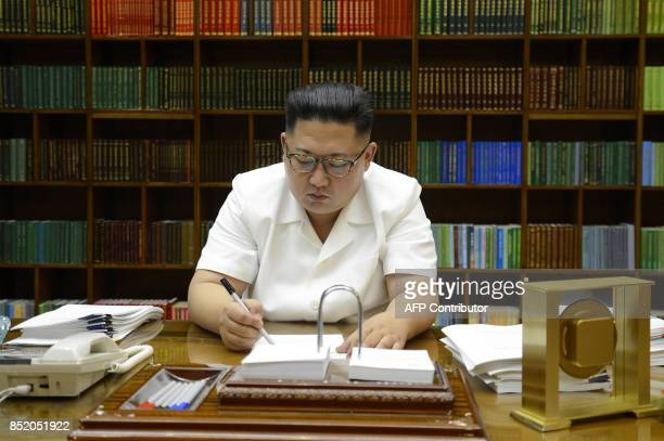 This July 27 2017 picture released from North Korea's official Korean Central News Agency on July 29 2017 shows North Korean leader Kim JongUn...