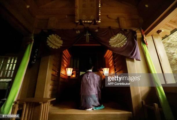 This July 8 2017 picture shows a Shinto priest holding a ritural ceremony at Okitsugu shrine of the Munakata Taisha in Okinoshima island some 60...