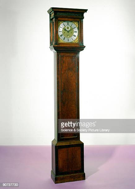 This long case clock in a walnut case was made by Thomas Tompion one of the finest English clockmakers Long case clocks were first made in England...