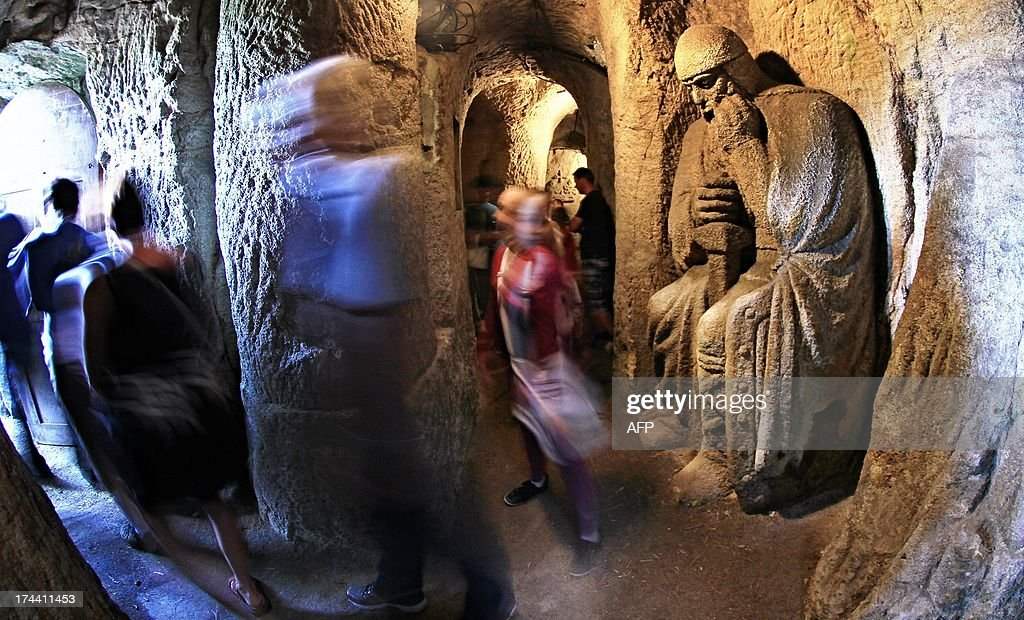 This long exposure photo shows people looking at knights which have been carved in the stonework in caves in Rudka village in South Moravia, 40 km north of Brno in the Czech Republic. The statues are by cave sculptor Stanislav Rolinek and were made in the 1930s. AFP PHOTO/RADEK MICA