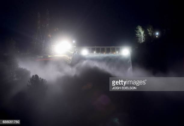 TOPSHOT This long exposure photograph shows the Oroville Dam discharging water at a rate of 100000 cubic feet per second over a spillway as an...