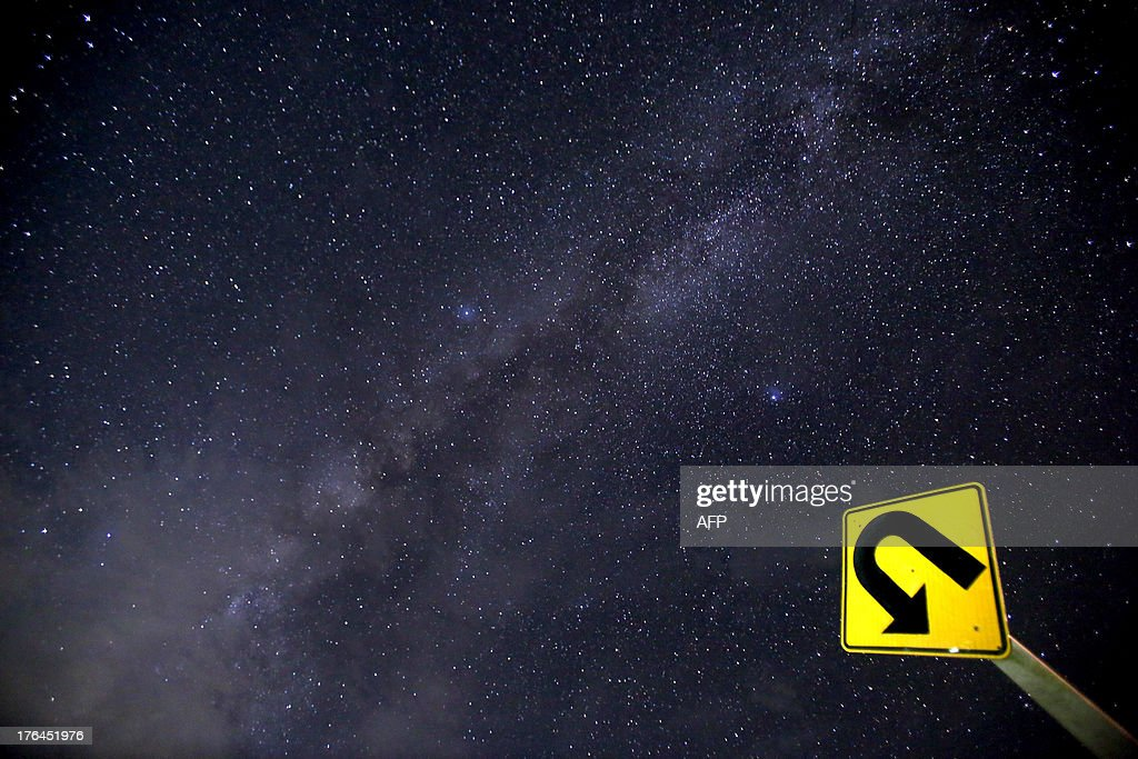 This long-exposure photograph taken on August 12, 2013 shows the Milky Way in the clear night sky near Yangon. The Perseid meteor shower occurs every year in August when the Earth passes through the debris and dust of the Swift-Tuttle comet. AFP PHOTO / Ye Aung Thu