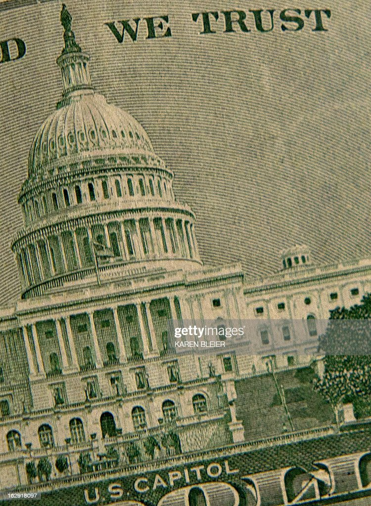 This March 1, 2013 photo illustration Taken in Manassas, Virginia, shows the US Capitol on the back of the twenty USD bill. US President Barck Obama met Friday with US Speaker of the House John Boehner and Congressional leaders. Obama summoned congressional leaders in a bid to avert a damaging $85 billion in arbitrary budget cuts. AFP PHOTO / Karen BLEIER