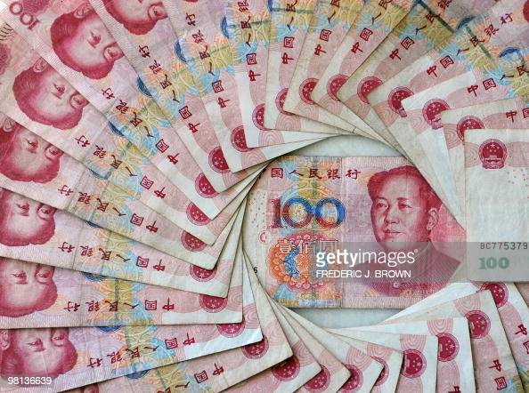 This March 17 2010 illustration in Beijing shows China's 100 Yuan or Renminbi notes the largest denomination in Chinese currency The World Bank has...