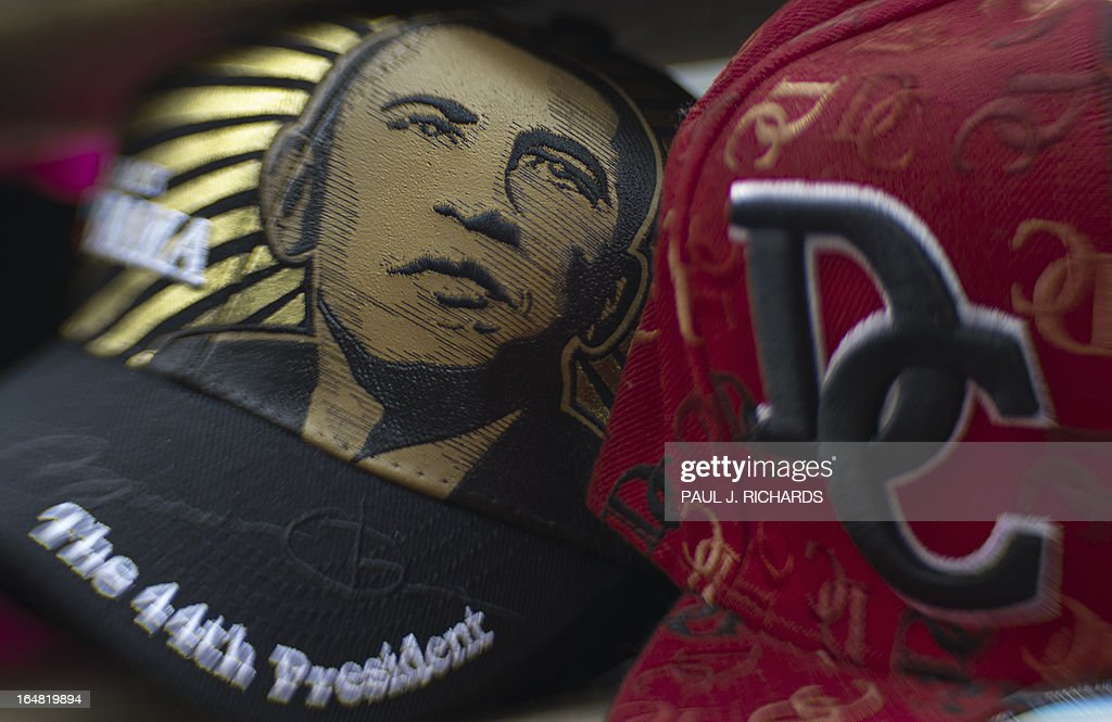 This March 28, 2013 photo illustration shot with a perspective control lens shows baseball style hats for sale at a street vendor's cart near the White House in Washington, DC. AFP PHOTO/Paul J. Richards