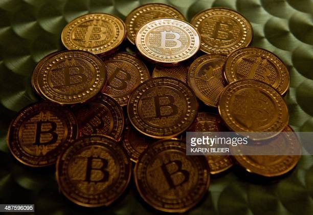 This May 1 2014 photo taken in Washington DC shows bitcoin medals AFP PHOTO / Karen BLEIER / AFP PHOTO