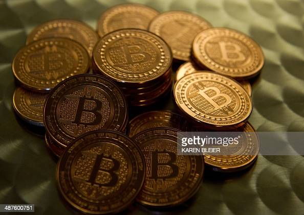 This May 1 2014 photo taken in Washington DC shows bitcoin medals Bitcoin uses peertopeer technology to operate with no central authority or banks...