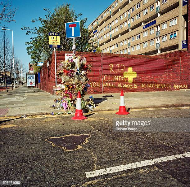 This memorial has been placed where a young man called 'Clinton' died on the A1206 Manchester Road London England UK If we drove past this place...