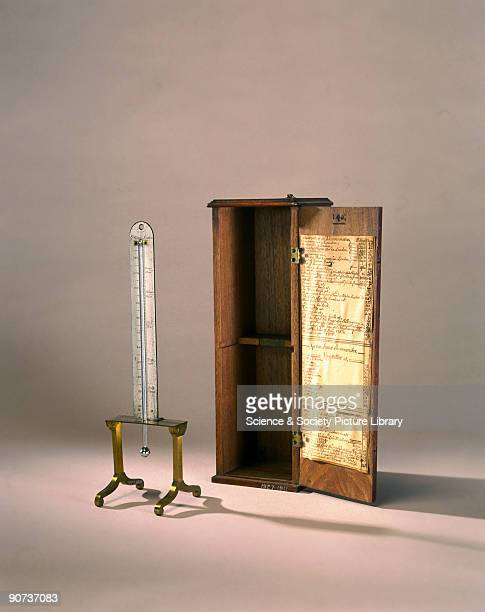 This mercuryinglass thermometer was used in the demonstration in which sal ammoniac was dropped in dilute sulphuric acid The whole apparatus was in a...