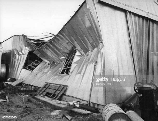 This metal building was caved in and equipment strewn about by a small but vicious tornado that tore across the plains near Castle Rock southeast of...