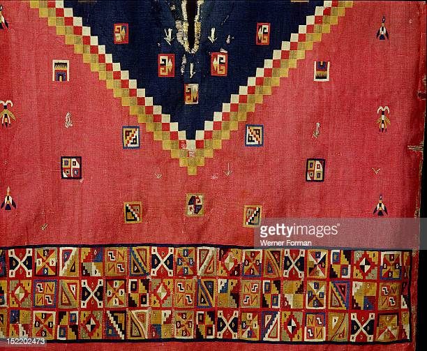 This multi coloured poncho is typical of Inca design with interlocking geometric patterns Worn by a nobleman this piece may have been preserved in a...