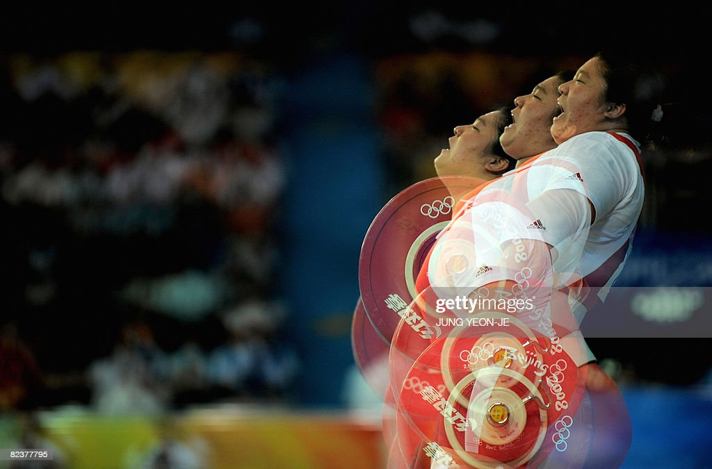This multiexposure picture shows Jang Miran of South Korea lifting a weight in the women's +75 kg weightlifting event during the 2008 Beijing Olympic Games on August 16, 2008.