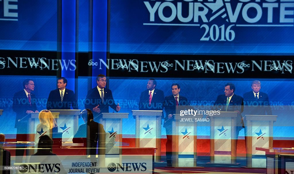 This multiple exposure picture shows candidates participating in the Republican Presidential Candidates Debate on February 6, 2016 at St. Anselm's College Institute of Politics in Manchester, New Hampshire. Seven Republicans campaigning to be US president are in a fight for survival in their last debate Saturday before the New Hampshire primary, battling to win over a significant number of undecided voters. / AFP / JEWEL SAMAD