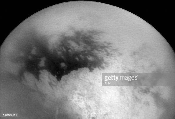 This NASA Cassini Spacecraft image released 14 December shows Saturn's moon Titan as Cassini approached it 11 December for its second close encounter...