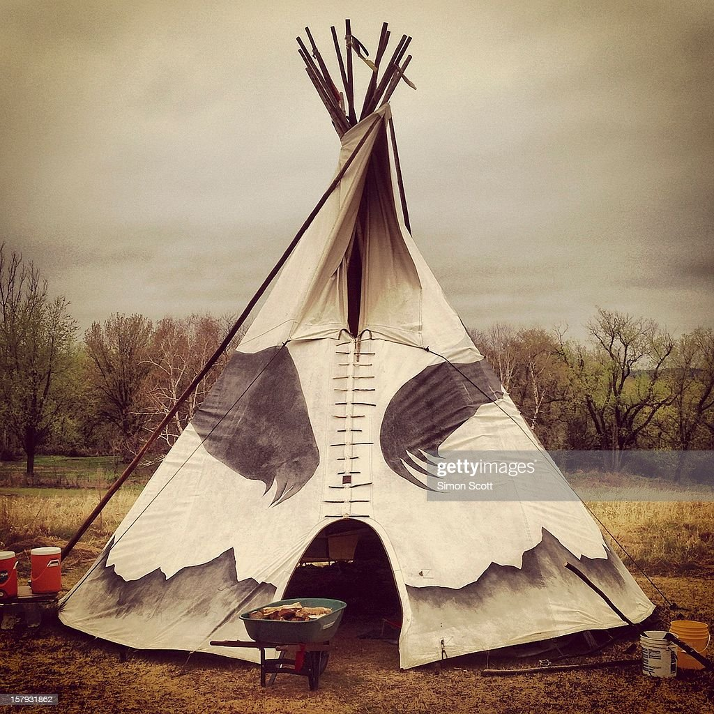 This Native American teepee is traditionally used for medicine ceremonies and for shelter. With a fireplace in the center, the smoke can exit rough a specially designed flap at the top. The material cover is supported by several long and straight poles which are tied at the top.