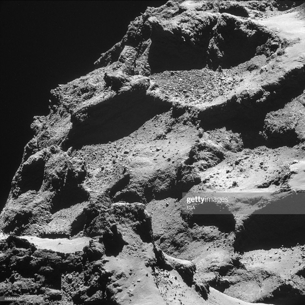 This November 11 2014 handout photo provided by the European Space Agency shows the surface of the 67P/ChuryumovGerasimenko comet taken from an...