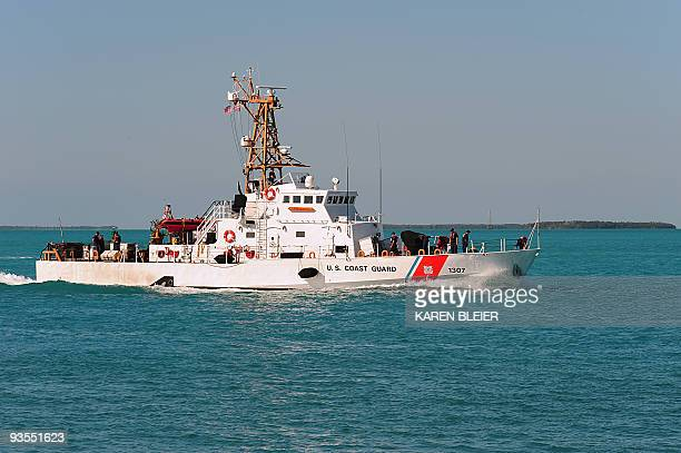 This November 29 2009 photo shows the US Coast Guard Cutter Ocracoke entering the harbor following a patrol in Key West Florida The Ocracoke...
