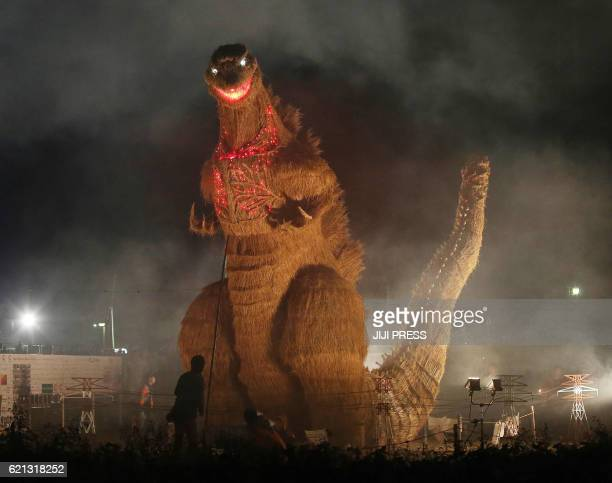 TOPSHOT This November 5 2016 picture shows a 7metertall and 10metrelong strawmade Godzilla being displayed at an autumn festival in Chikuzen Fukuoka...