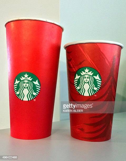 This November 9 2015 photo shows the 2014 and 2015 Starbucks holiday cups in Washington DC The unadorned 2015 red cup which debuted November 1 came...