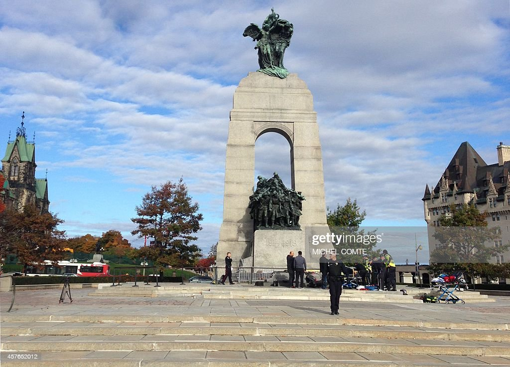 This October 22 2014 photo shows police at the scene of a shooting at the National War Memorial in Ottawa Canada Parliament Hill's Centre Block is in...