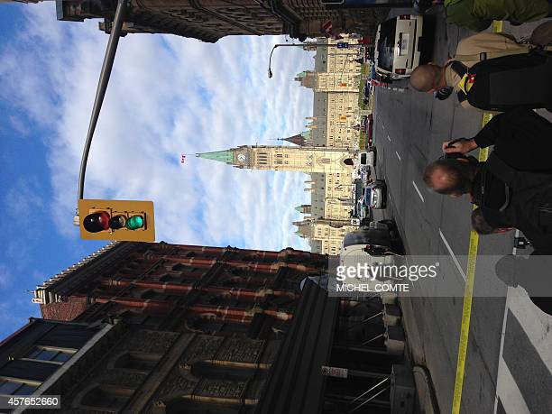 This October 22 2014 photo shows the Parliament building and police after a shooting at the National War Memorial in Ottawa Canada Parliament Hill's...
