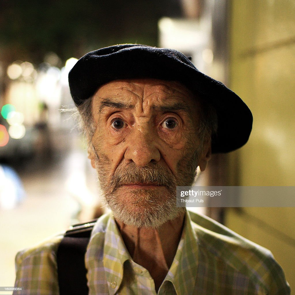 CONTENT] This old man was drifting slowly through the streets on a hot Friday night in Zaragoza. Spanish street are usually crowded on a week-end night but you usually only see young people. This man kindly accepted to pose when I asked him.