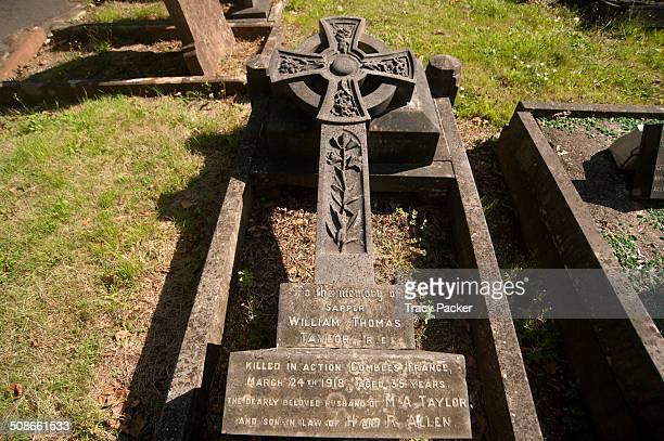 This ornate stone cross marks the death of Sapper William Thomas Taylor of the Royal Engineers who was killed in action in Combles 1918 aged 35...